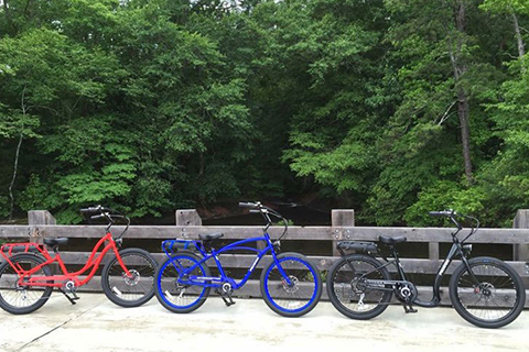 A trio of bikes at the Shallowford Bridge, where guests staying at Xplorie participating properties can enjoy a free Shallowford Bridge River Tour from Pedego Bikes in Blue Ridge, Georgia.