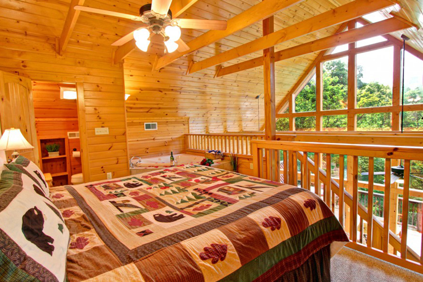 Auntie Belham's Cabin Rentals bedroom with mountain view and high ceilings on mountain in Pigeon Forge, Tennessee