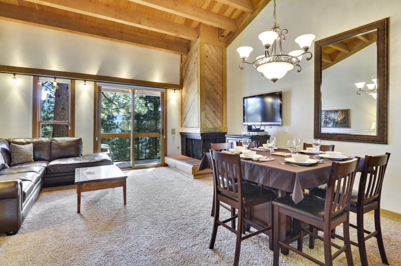 Stay In Lake Tahoe Rentals cabin living room with high ceiling in Lake Tahoe, California