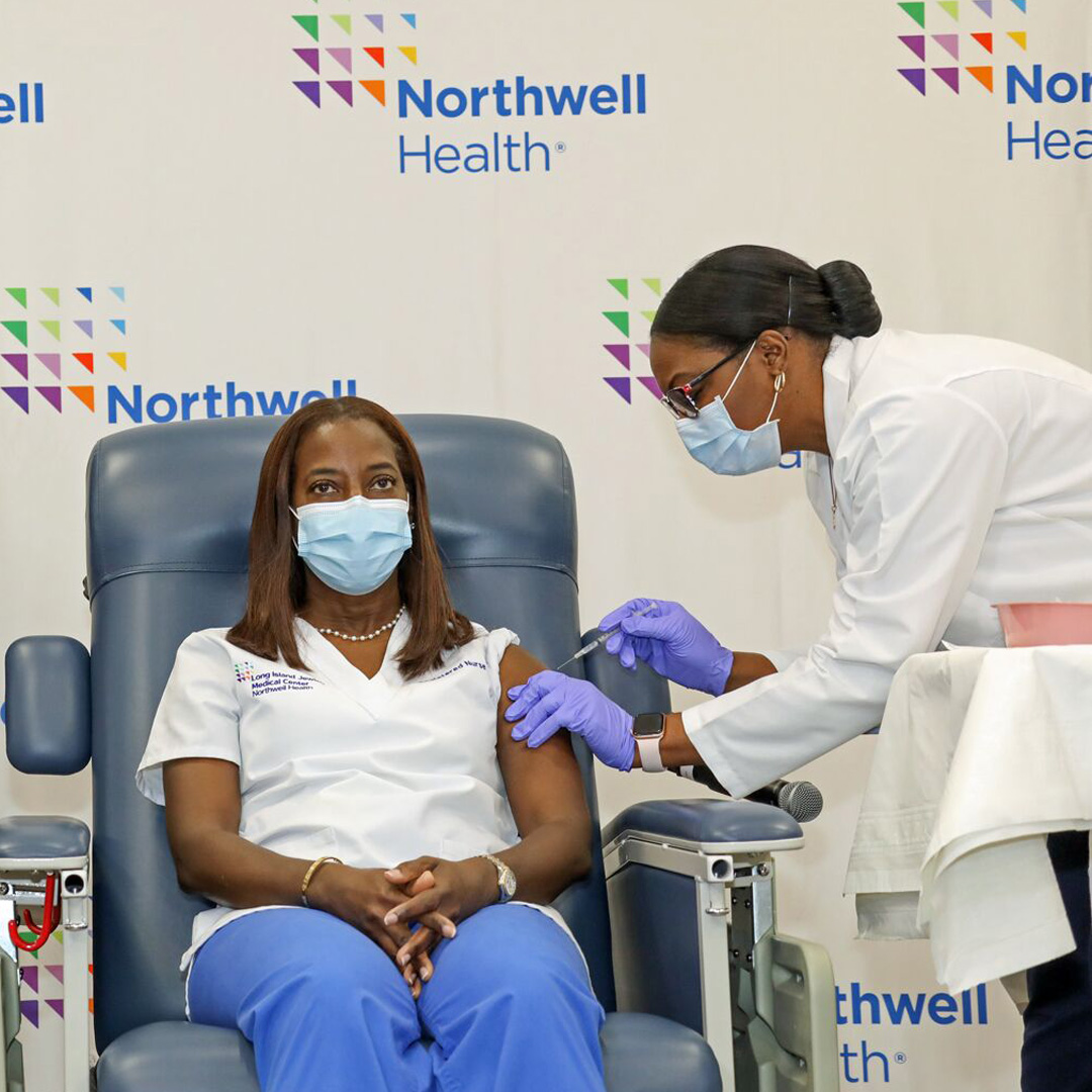 Healthcare worker receiving the COVID-19 Vaccine